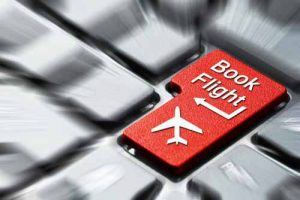 """A keyboard with a key """"Book Flight"""" highlighted"""