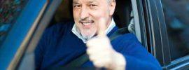 """A customer gives a """"thumbs-up"""" at a car dealership."""