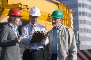 Contractors inspect a project.