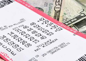 Lottery tickets lie on top of money