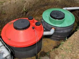 Septic tanks in the ground.