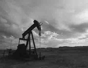 An oil well in a field.