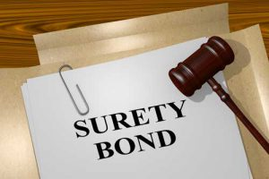 A surety bond document in a court room.
