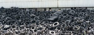 Tires are piled up at a used tire storage site.