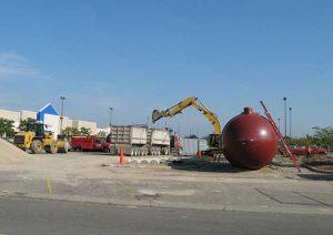 An underground storage tank is being prepared for use.